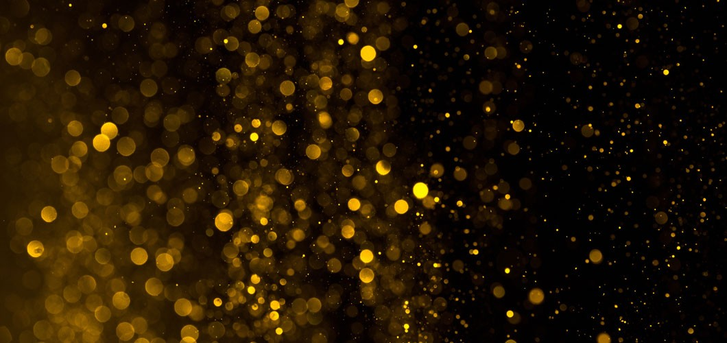 Image of gold flakes on black background