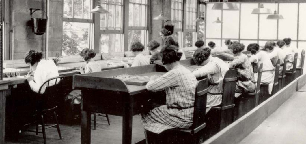 Radium Girls work in a factory of the United States Radium Corporation.