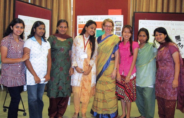 Photo of Amber Wise with students in Bangladesh, India
