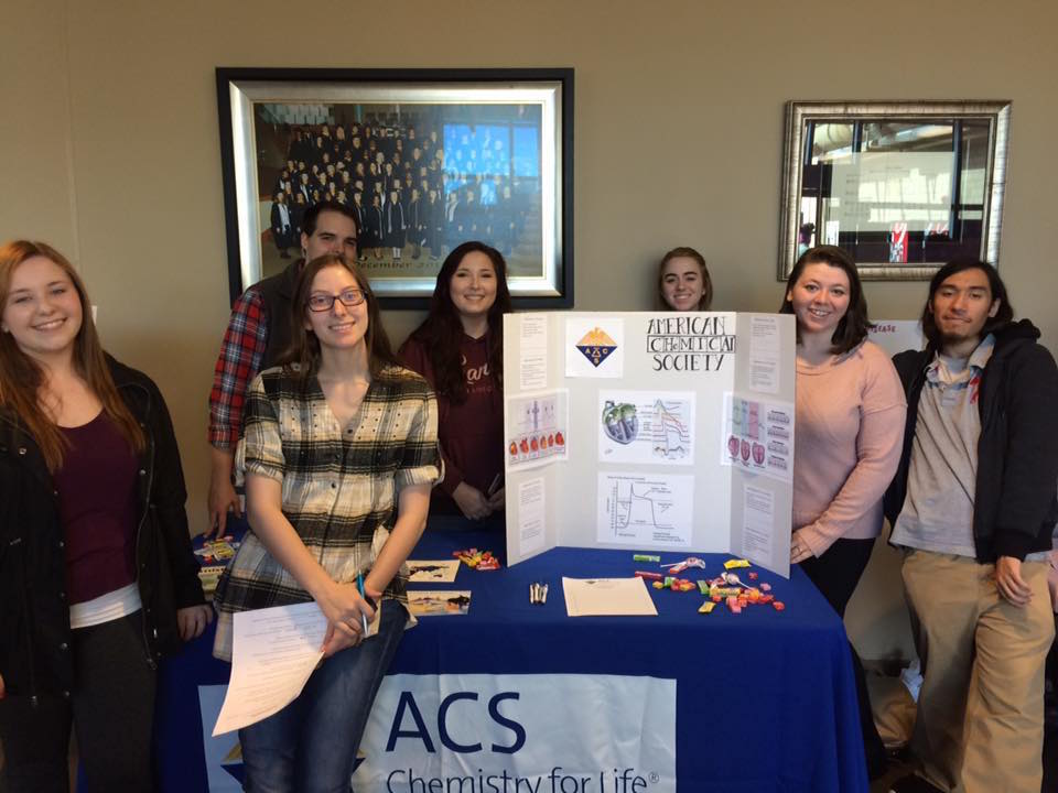 Chapter members host a table at Baptist College's annual heart fair.