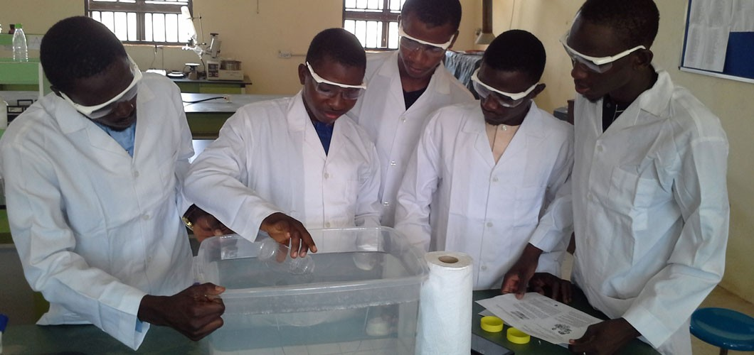 students for Sokoto State University perform science experiments during conference